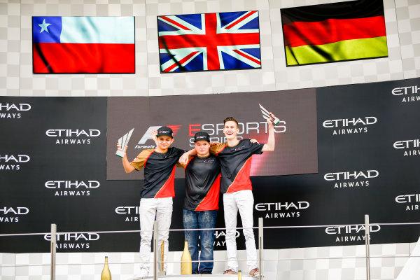 Yas Marina Circuit, Abu Dhabi, United Arab Emirates. Sunday 26 November 2017. Fabrizio Denoso Delgado, champion Brendon Leigh, and Sven Zurner on the E-Sports podium. World Copyright: Andy Hone/LAT Images  ref: Digital Image _ONY3170