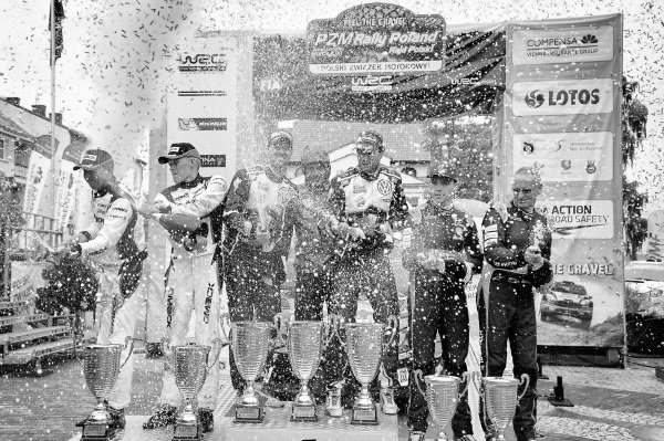 Second placed Ott Tanak (EST) / Raigo Molder (EST), Drive DMACK World Rally Team WRC, Rally winners Andreas Mikkelsen (NOR) / Anders Jaeger Synnevag (NOR), Volkswagen Motorsport II WRC and Hayden Paddon (NZL) / John Kennard (NZL), Hyundai Motosport WRC celebrate on the podium with the champagne at FIA World Rally Championship, Rd7, Rally Poland, Day Three, Mikolajki, Poland, 3 July 2016.