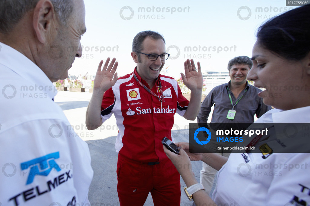 Stefano Domenicali jokes around with Peter Sauber and Monisha Kaltenborn.