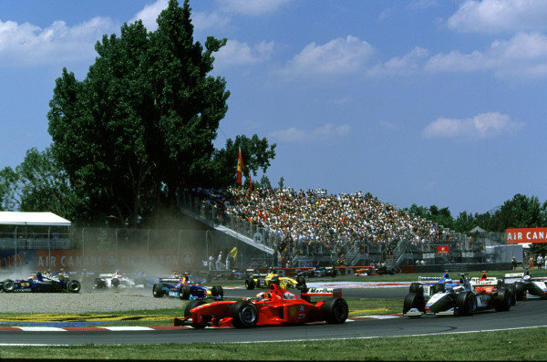 1999 Canadian Grand Prix.Montreal, Quebec, Canada.11-13 June 1999.Michael Schumacher (Ferrari F399) leads the field.Ref-99 CAN 08.World Copyright - LAT Photographic