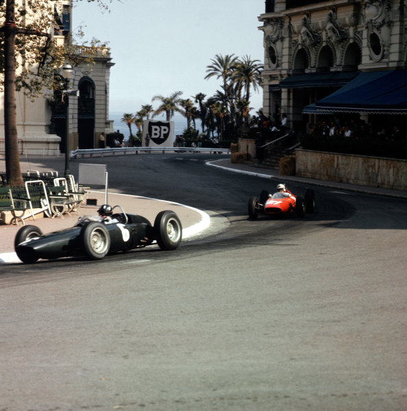 Monte Carlo, Monaco.23-26 May 1963.Graham Hill (BRM P57) leads John Surtees (Ferrari Dino 156) in Casino Square. They finished in 1st and 4th positions respectively.Ref-3/0917.World Copyright - LAT Photographic