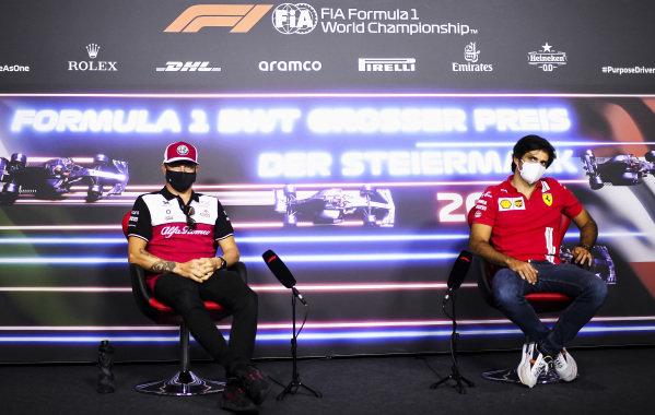 Kimi Raikkonen, Alfa Romeo Racing and Carlos Sainz, Ferrari in the Press Conference