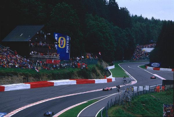 2002 Belgian Grand Prix.Spa-Francorchamps, Belgium. 30/8-1/9 2002.The Ferrari F2002's of Michael Schumacher and Rubens Barrichello go through the newly revised Eau Rouge.Ref-02 BEL 14.World Copyright - Coates/LAT Photographic