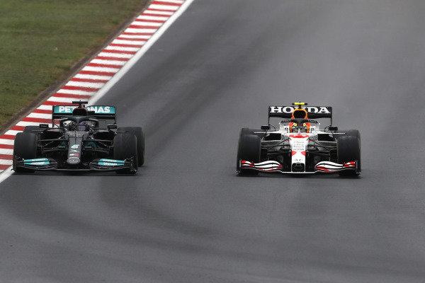 Sir Lewis Hamilton, Mercedes W12, battles with Sergio Perez, Red Bull Racing RB16B
