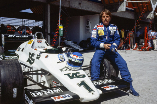 Keke Rosberg on the wheel of his Williams FW08C Ford. His helmet is on the nosecone.