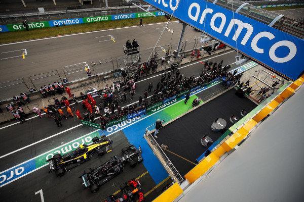 The teams gather around the podium prior to the ceremony