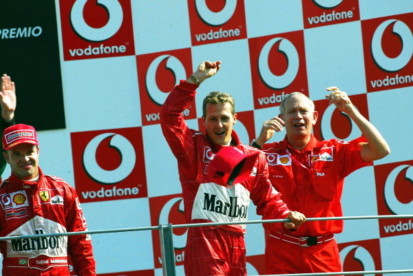 Rubens Barrichello (BRA) Ferrari winner; Michael Schumacher (GER) Ferrari second; Rory Byrne (RSA) Ferrari Chief Designer.