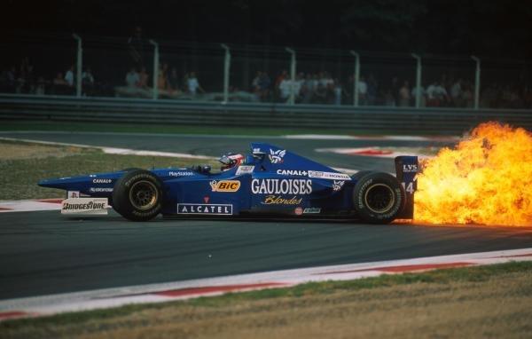 Jarno Trulli (ITA) Ligier spins due to a huge oil fire Formula One World Championship, Italian Grand Prix, Rd13, Monza, Italy, 7 September 1997.