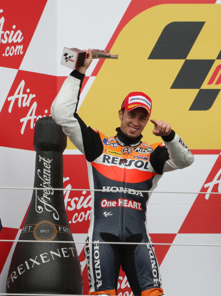 British Grand Prix. Silverstone, England. 10th-12th June 2011. Andrea Dovizioso, Honda, with the 2nd place trophy on the podium. World Copyright: Kevin Wood/LAT Photographic. ref: Digital Image