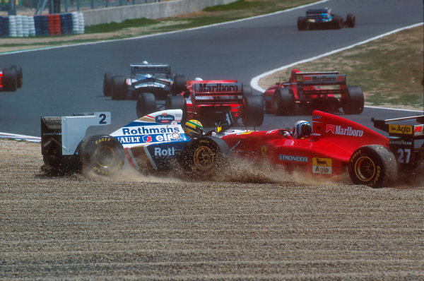 Tanaka International, Aida, Japan.15-17 April 1994.Ayrton Senna (Williams FW16 Renault) and Nicola Larini (Ferrari 412T1) end up in the gravel together at the first corner, after Senna had been helped into a spin by Hakkinen which left Larini no where to go.Ref-94 PAC 03.World Copyright - LAT Photographic