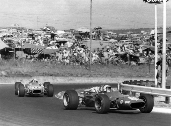 1968 South African Grand Prix.Kyalami, South Africa. 1 January 1968.Chris Amon, Ferrari 312, 4th position, leads John Love, Brabham BT20-Repco, 9th position, action.World Copyright: LAT PhotographicRef: Autosport b&w print