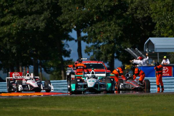 2-4 September, 2016, Watkins Glen, New York USA Simon Pagenaud passes the crashed car of Will Power ?2016, Phillip Abbott LAT Photo USA