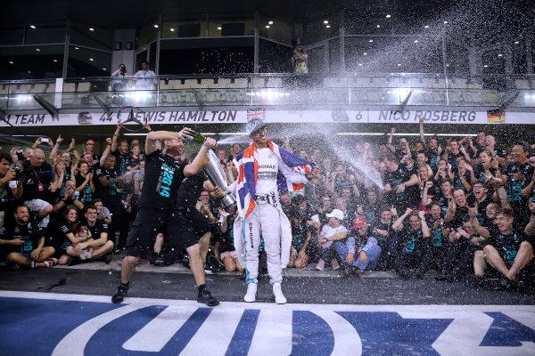 Yas Marina Circuit, Abu Dhabi, United Arab Emirates. Sunday 23 November 2014.  Lewis Hamilton and the Mercedes team celebrate championship victory.  World Copyright: Steve Etherington/LAT Photographic. ref: Digital Image SNE22526