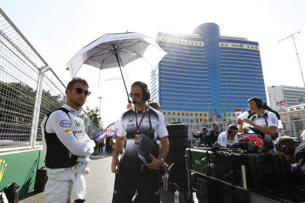Baku City Circuit, Baku, Azerbaijan. Saturday 18 June 2016. Jenson Button, McLaren, and Tom Stallard, Race Engineer, McLaren, on the grid. World Copyright: Steven Tee/LAT Photographic ref: Digital Image _H7I0663