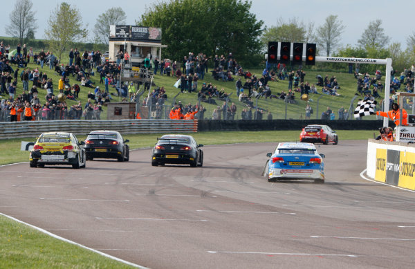 2015 British Touring Car Championship  Round 3 - Thruxton, Hampshire.  Thruxton, 9th-10th May 2015.  Jason Plato and Aron Smith, BMR Volkswagen, Josh Cook, Power Maxed Chevrolet, and Tom Ingram, Speedworks Toyota, cross the finish line.  Ref: _W7_4421a. World copyright: Kevin Wood/LAT Photographic