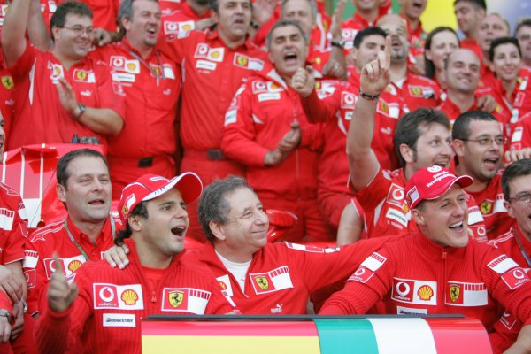 2006 Brazilian Grand Prix - Sunday Race Interlagos, Sao Paulo, Brazil. 19th - 22nd October 2006. The Ferrari team say goodbye to Michael Schumacher after the 7 times World Champion retires, portrait. World Copyright: Lorenzo Bellanca/LAT Photographic ref: Digital Image MU4Z4413