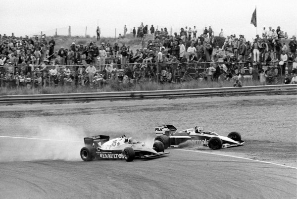 Nelson Piquet (BRA) Brabham BT52B (Right) heads into the tyre barrier at Tarzan after being hit by Alain Prost (FRA) Renault RE40 (Left) on lap 42 when Alain lost control whilst trying to overtake him. Piquet retired on the spot, Prost crashed out later that lap having suffered damage to the front wing.