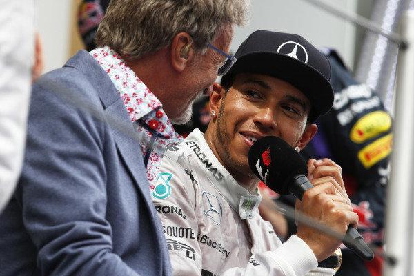 Circuit de Catalunya, Barcelona, Spain. Sunday 11 May 2014. Eddie Jordan, TV Pundit, BBC Sport F1, interviews Lewis Hamilton, Mercedes AMG, 1st Position, on the podium. World Copyright: Steven Tee/LAT Photographic. ref: Digital Image _L4R4382