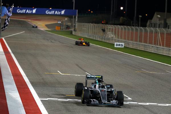 Bahrain International Circuit, Sakhir, Bahrain. Sunday 3 April 2016. Nico Rosberg, Mercedes F1 W07 Hybrid crosses the line to win the race. World Copyright: Glenn Dunbar/LAT Photographic ref: Digital Image _89P0184