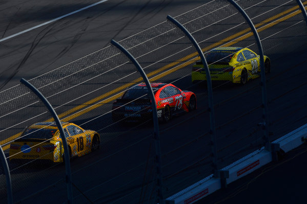 13-21 February, 2016, Daytona Beach, Florida USA Matt Kenseth, Dollar General Toyota Camry, Martin Truex Jr, Furniture Row Toyota Camry, and Kyle Busch, M&M's 75 Toyota Camry speed to turn one as the west side of the track falls into shadow in the closing laps. ?2016, F. Peirce Williams LAT Photo USA