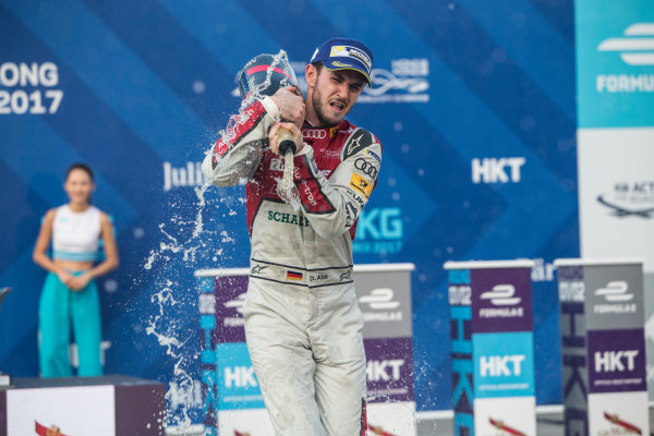 2017/2018 FIA Formula E Championship. Round 2 - Hong Kong, China. Sunday 03 December 2017. Daniel Abt (GER), Audi Sport ABT Schaeffler, Audi e-tron FE04, sprays the champagne on the podium. Photo: Andrew Ferraro/LAT/Formula E ref: Digital Image _X0W4047