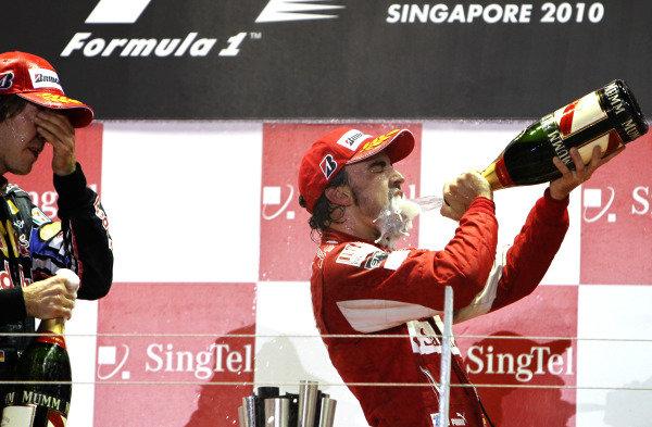 Marina Bay Circuit, Singapore. 26th September 2010. Fernando Alonso, Ferrari F10, 1st position, celebrates with Champagne. Portrait. Podium.  World Copyright: Glenn Dunbar /LAT Photographic ref: Digital Image _G7C9013