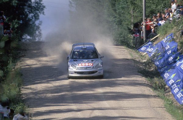 2000 World Rally Championship.1000 Lakes Rally, Finland. 18-20 August 2000.Marcus Gronholm/Timo Rautiainen (Peugeot 206 WRC), 1st position.World Copyright: LAT PhotographicRef: 35mm transparency 2000RALLY09