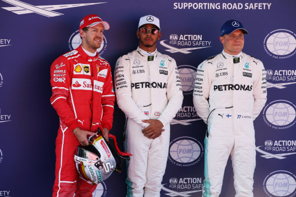 Circuit de Catalunya, Barcelona, Spain. Saturday 13 May 2017. Top three qualifiers Lewis Hamilton, Mercedes AMG, Sebastian Vettel, Ferrari, and Valtteri Bottas, Mercedes AMG. World Copyright: Charles Coates/LAT Images ref: Digital Image DJ5R8863