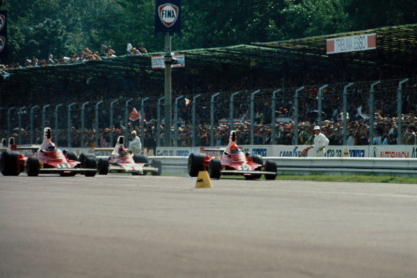 Monza, Italy. 5 - 7 September 1975.Niki Lauda (Ferrari 312T),3rd position, leads Clay Regazzoni (Ferrari 312T), 1st position and Emerson Fittipaldi (McLaren M23-Ford), 2nd position, at the start, action. World Copyright: LAT Photographic.Ref:  75ITA05.