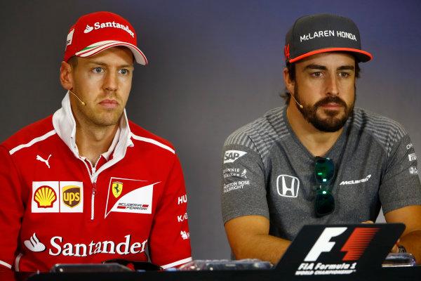 Hungaroring, Budapest, Hungary.  Thursday 27 July 2017. Sebastian Vettel, Ferrari, and Fernando Alonso, McLaren, in the Thursday press conference. World Copyright: Andy Hone/LAT Images  ref: Digital Image _ONY8522