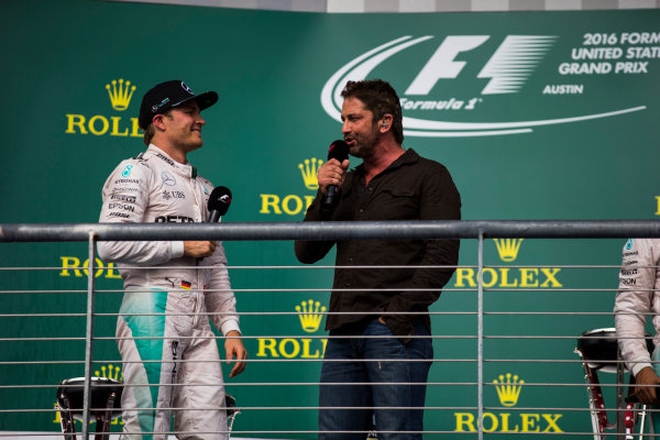 Circuit of the Americas, Austin Texas, USA. Sunday 23 October 2016. Nico Rosberg, Mercedes AMG, 2nd Position, is interviewed by Gerard Butler on the podium. World Copyright: Sam Bloxham/LAT Photographic ref: Digital Image _SLA2679_1