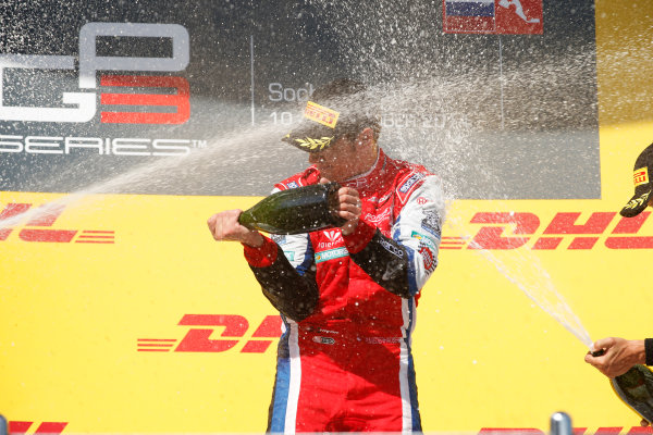 2014 GP3 Series. Round 8.   Sochi Autodrom, Sochi, Russia. Sunday Race 2 Sunday 12 October 2014. Patric Niederhauser (SUI, Arden International) sprays the champagne on the podium. Photo: Glenn Dunbar/GP3 Series Media Service. ref: Digital Image _89P3013