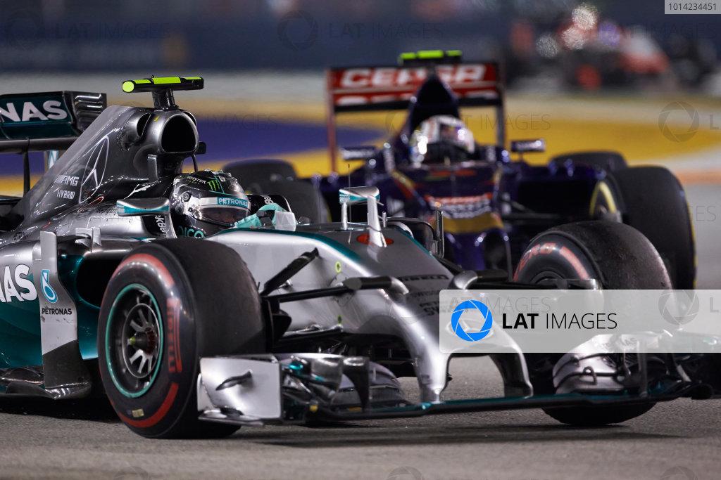 Marina Bay Circuit, Singapore. Sunday 21 September 2014. Nico Rosberg, Mercedes F1 W05 Hybrid, leads Daniil Kvyat, Toro Rosso STR9 Renault. World Copyright: Steve Etherington/LAT Photographic. ref: Digital Image SNE21340