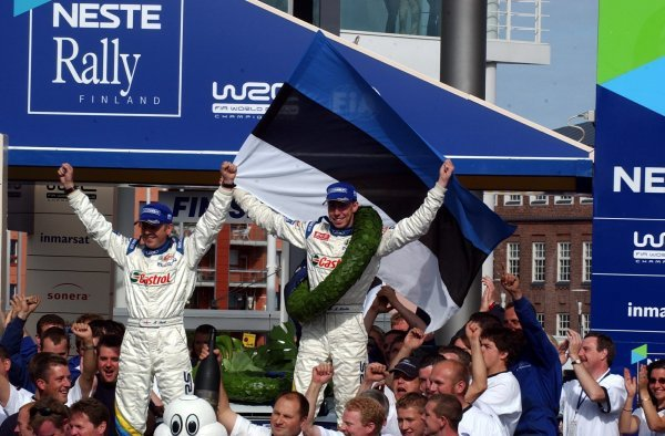 Rally winner Markko Martin (EST), right, and Michael Park (GBR), Ford, celebrate their win on the podium in front of a huge Estonian crowd.
