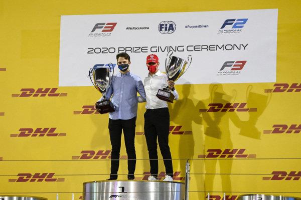 F3 Championship 1st position Oscar Piastri (AUS, PREMA RACING) and F2 Championship 1st postion Mick Schumacher (DEU, PREMA RACING) celebrate on the podium with the trophy