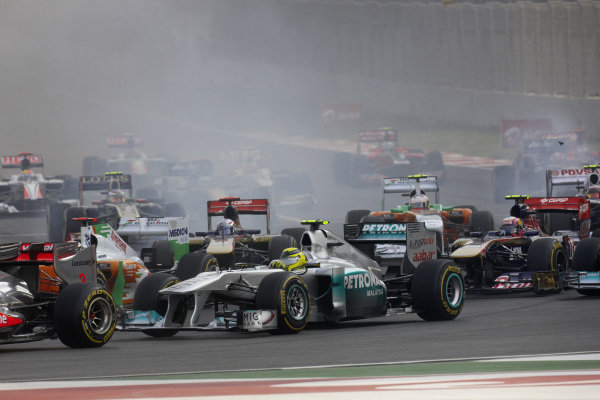 Nico Rosberg, Mercedes MGP W02, in the thick of the action at the first corner.