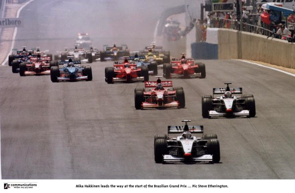1998 Brazilian Grand Prix.Interlagos, Sao Paulo, Brazil.27-29 March 1998.Mika Hakkinen (McLaren MP4/13 Mercedes-Benz) leads the way at the start. He finished in 1st position.World Copyright - Steve Etherington/LAT Photographic