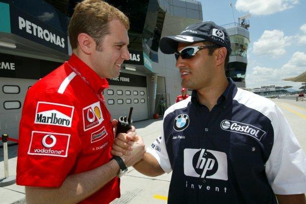(L to R): Stefano Domenicali (ITA) Ferrari Director of F1 Racing Activities shakes hands with Juan Pablo Montoya (COL) Williams.Formula One World Championship, Rd2, Malaysian Grand Prix, Race Day, Sepang, Malaysia, 23 March 2003.DIGITAL IMAGE