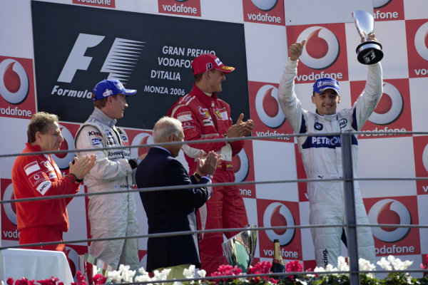 Robert Kubica celebrates his first podium for 3rd position and the first for any Polish driver in F1 history. Alongside him are winner Michael Schumacher and 2nd placed Kimi Räikkönen.