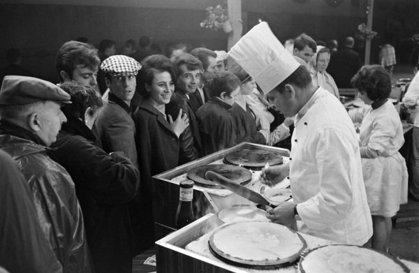 Fans queue for crepes during the night.