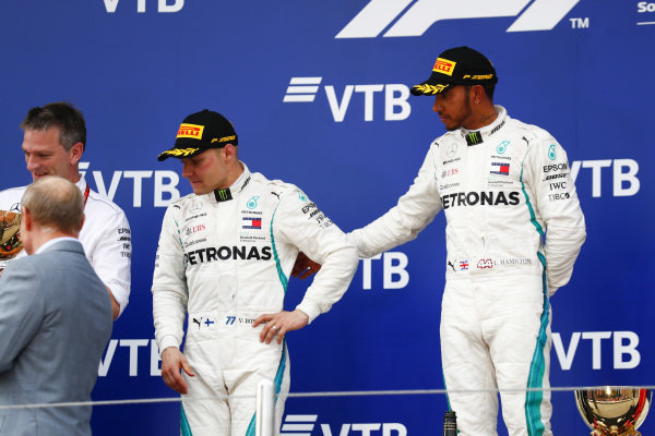Lewis Hamilton, Mercedes AMG F1, 1st position, consoles team mate Valtteri Bottas, Mercedes AMG F1, 2nd position, on the podium