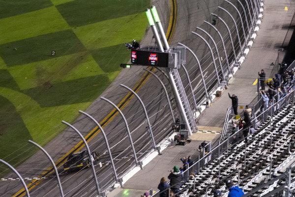 #54: Ty Gibbs, Joe Gibbs Racing, Toyota Supra Monster Energy checkered flag