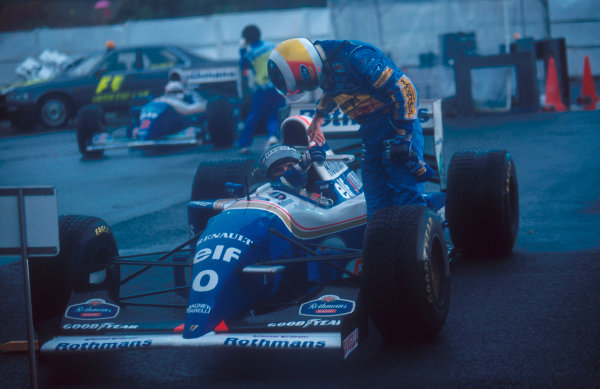 Suzuka, Japan. 4th - 6th November 1994. Damon Hill (Williams FW16B Renault) 1st position is congratulated by Michael Schumacher (Benetton Ford) who finished in 2nd position.Ref-94 JAP 11.World Copyright - LAT Photographic