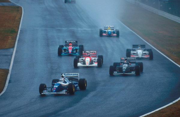 Suzuka, Japan. 4th - 6th November 1994. Nigel Mansell (Williams FW16B Renault) followed by Heinz-Harald Frentzen (Sauber C13 Mercedes), Mika Hakkinen (McLaren MP4/9 Peugeot), Mark Blundell (Tyrrell 022 Yamaha) and Eddie Irvine (Jordan 194 Hart).Ref-94 JAP 08.World Copyright - LAT Photographic
