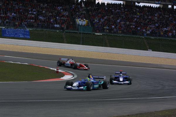 2002 European Grand Prix - Sunday RaceNurburgring, Germany. 23rd June 2002.Felipe Massa, Sauber Petronas C21, leads team mate Nick Heidfeld, action.World Copyright: LAT Photographic.ref: Digital Image Only