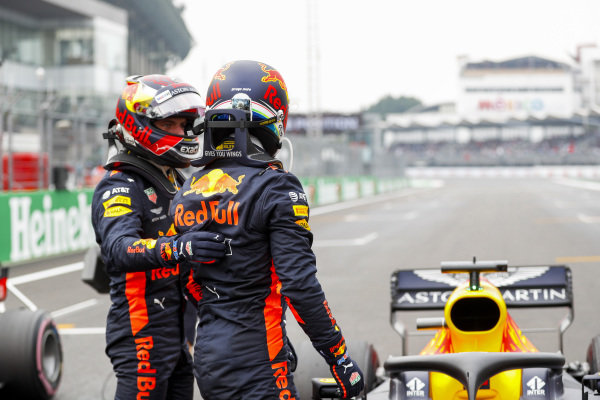 Max Verstappen, Red Bull Racing, congratulates team mate Daniel Ricciardo, Red Bull Racing, on pole