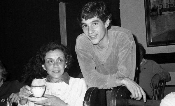 Race winner and 1983 British Formula 3 Champion Ayrton Senna (GBR) West Surrey Racing with his mother Neide Senna da Silva (BRA) at the after race party. British Formula 3 Championship, Rd18, Marlboro Championship Race, Thruxton, England, 23 October 1983.