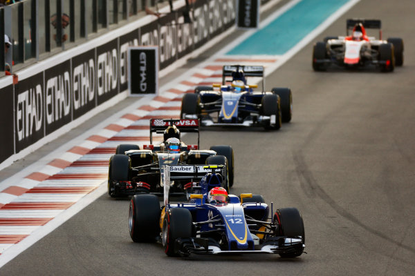 Yas Marina Circuit, Abu Dhabi, United Arab Emirates. Sunday 29 November 2015. Felipe Nasr, Sauber C34 Ferrari, leads Romain Grosjean, Lotus E23 Mercedes, and Marcus Ericsson, Sauber C34 Ferrari. World Copyright: Glenn Dunbar/LAT Photographic ref: Digital Image _89P1714
