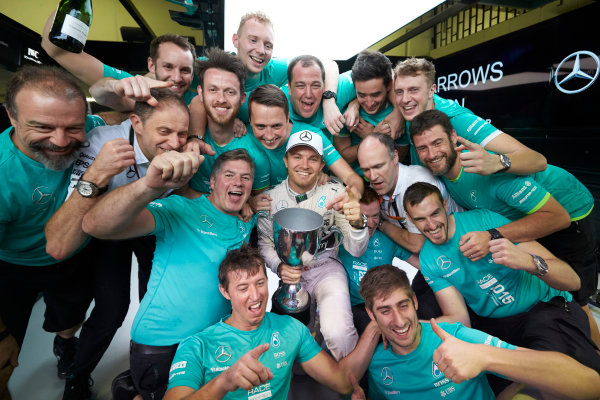 Interlagos, Sao Paulo, Brazil. Sunday 15 November 2015. Nico Rosberg, Mercedes AMG, 1st Position, and the Mercedes team celebrate victory. World Copyright: Steve Etherington/LAT Photographic ref: Digital Image SNE13188