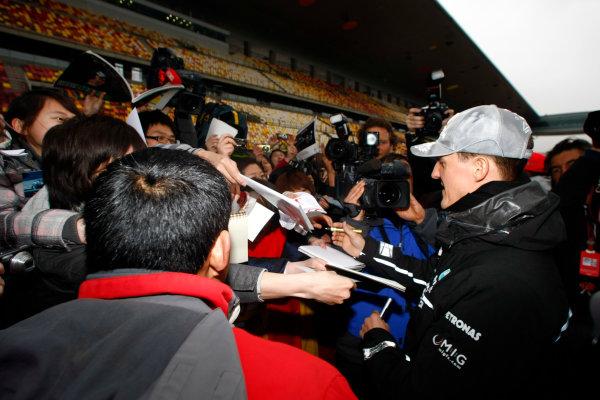 Shanghai International Circuit, Shanghai, China15th April 2010Michael Schumacher, Mercedes GP W01, signs some autographs for fans. Portrait. Atmosphere. World Copyright: Charles Coates/LAT Photographicref: Digital Image _26Y7797